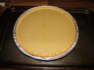 preparing pumpkin pie image