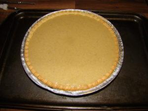 preparing pumpkin pie image